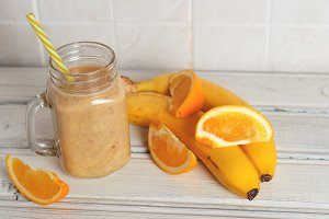 Smoothie with orange and banana in a