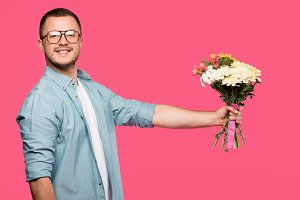 handsome young man holding bouquet o