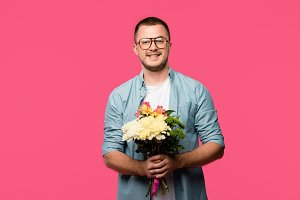 happy young man holding bouquet of f