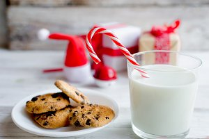 Santa's cookies with milk in glass.