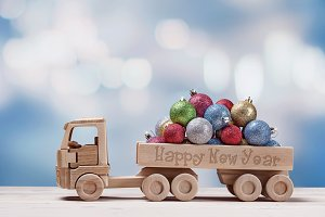 Toy car with christmas balls.