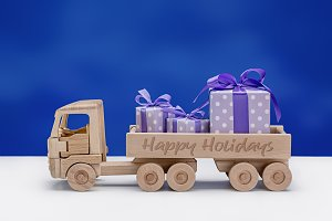 Wooden toy truck with gifts.