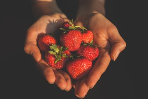 Strawberries in hands 2