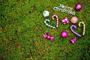 Christmas baubles on green moss