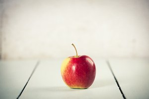 Apple on white wooden background, sp