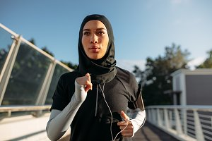 Healthy sporty woman in hijab