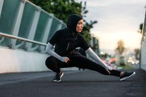 Hijab girl exercising outdoors