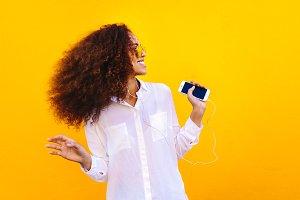 African girl enjoying listening