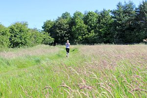 Runner Girl Running in Grassland