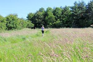Runner Girl Running in Grassland