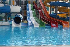 Water park. Blue pool slide swimming