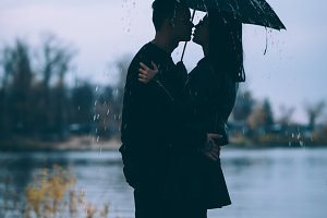 young couple standing under a dark u
