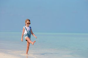 Adorable little girl at beach during