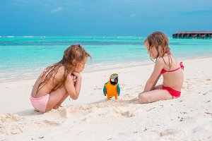 Adorable little girls at beach with