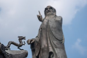 Dragon by statue of Lao Tze at