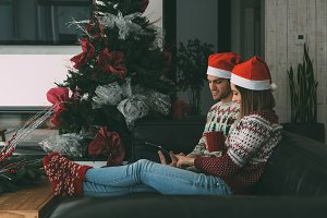 Young man and woman enjoy Christmas