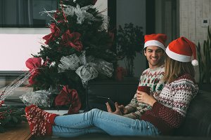 Young man and woman enjoying Christm