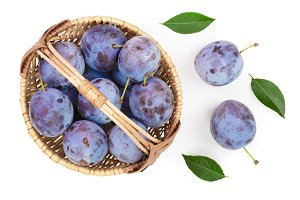 plums in wicker basket isolated on a