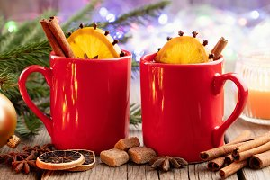 Red mugs of hot mulled wine.