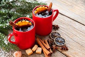 Red mugs of Chrismas mulled wine.