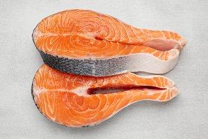 Fresh raw salmon fish steaks.