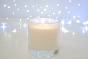 White candle on white background