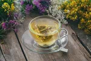 Tea cup with tea bag of herbal tea.