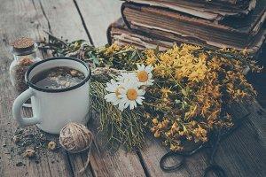Tea cup, medicinal herbs, old books
