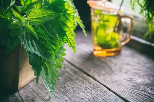 Bunch of nettle herbs and nettle tea