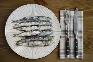 grilled sardine plate on wooden tabl