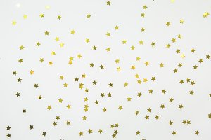 Golden star sprinkles on white