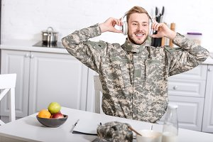 smiling army soldier in headphones s