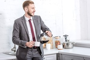 Young businessman in the kitchen