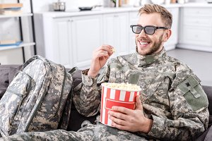 Young soldier spending time at home