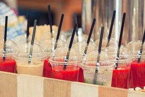 vivid drink in plastic glasses