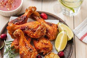 Tasty appetizing baked chicken legs