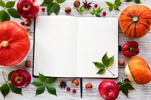 Empty notebook with pumpkins
