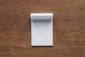 top view of blank notebook on wooden