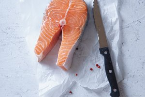 A steak of raw salmon