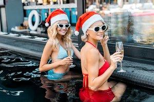 beautiful women in santa claus hats