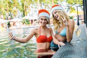 young pretty women in santa claus ha
