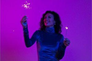 Woman holding festive burning