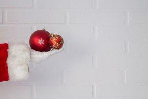 Santa Claus hand holding christmas b