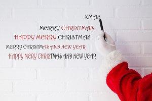 santa claus writing christmas and ne