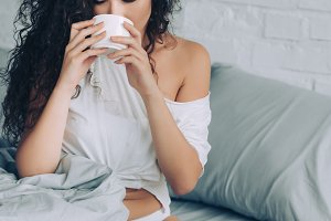 attractive curly woman drinking coff