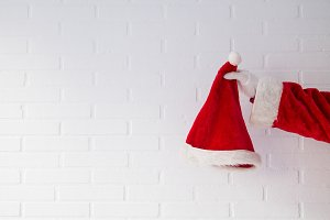 Santa Claus hand holding hat on whit