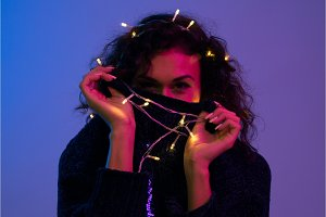 Young woman with xmas glowing lights