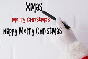 santa claus writing christmas and ne