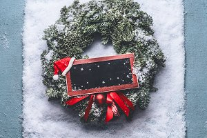 Christmas wreath on snow, mock up