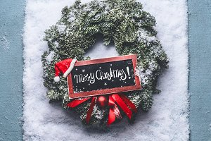 Merry Christmas wreath on snow